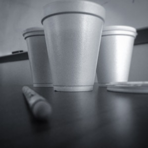 three cups of coffee sitting on a desk