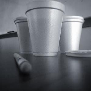 three cups of coffee sitting on a desk